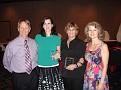 Michael and Deborah Hutchinson award Karen Permetti and Wynette Jameson with plaques as originators of the scholarship.