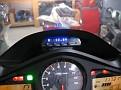 """The display was mounted on the dash with a base formed from """"plumbers epoxy putty"""". The Whistler 3500 also gives you voltage and outside temperature."""