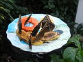 more butterflys on a plate with butterfly junk food