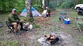 Chris Austin, sitting around the camp fire.