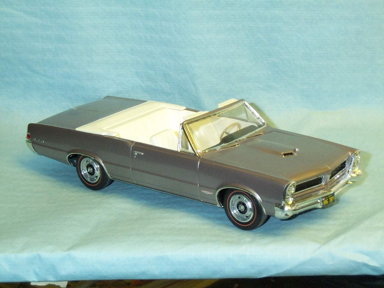 65 GTO convertible Original first issue kit restored from a poor build up. Wheels tires from new 66 GTO. Done in factory Iris Mist Metallic (very rare color on the real car)