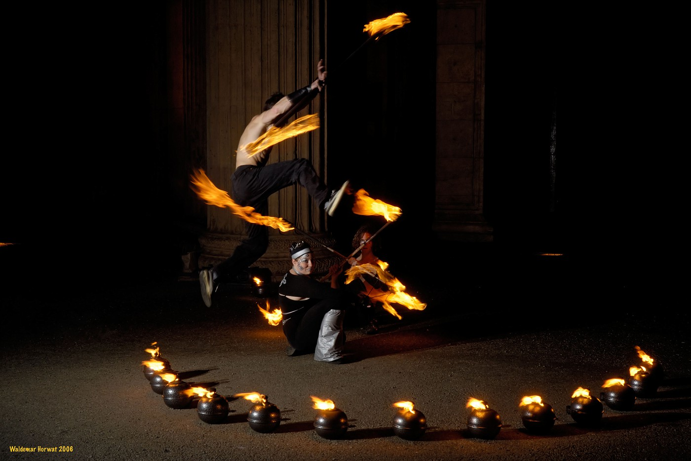 Leaping over Fire Dancers