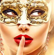 Beauty model woman wearing venetian masquerade carnival mask at party over holiday glowing gold back