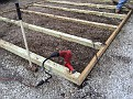 Positioning, Leveling and Securing the 4x4 Pressure Treated Base Framework I built to provide a good foundation for the new honey house.  Thanks for helping, Jonathan!!!