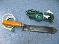 Dmitri!!!  Here is the hot knife all cleaned up.  As you can see it is electric and has and on-off extension cord.