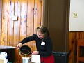 Cecelia Berg demonstrates Filtering hot and melted Bees Wax.